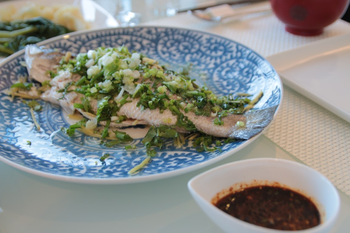 Steamed Sea bass with spicy sauce